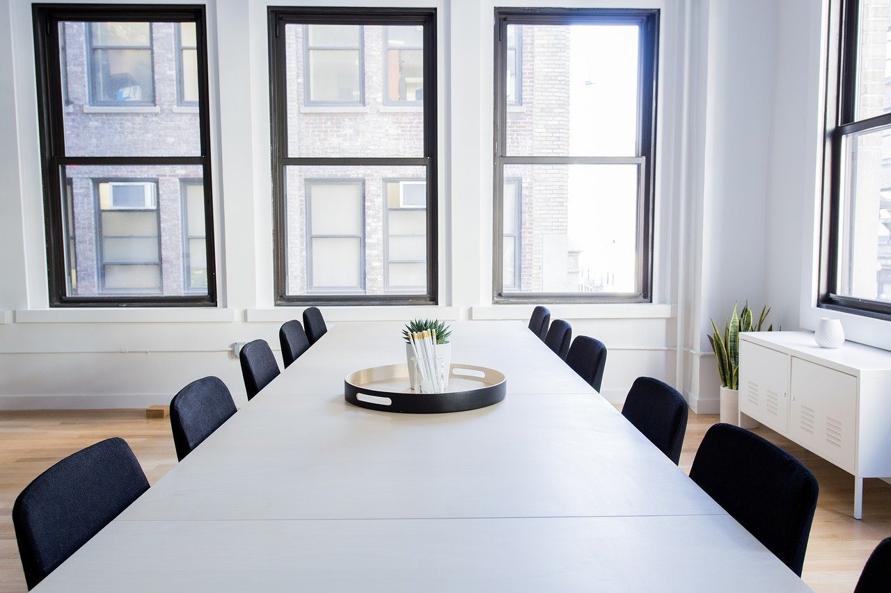 Empty conference table and chairs